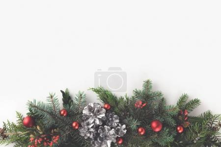 Photo for Top view of christmas fir branches with christmas balls and pine cones, isolated on white with copy space - Royalty Free Image