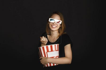 woman with bucket of popcorn