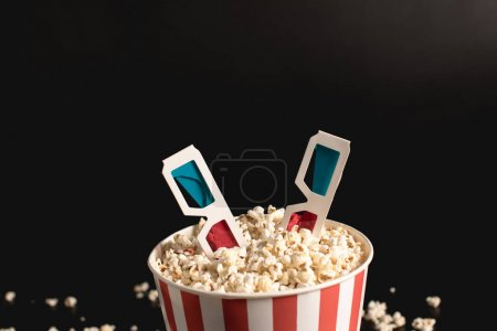 bucket of popcorn with 3d glasses