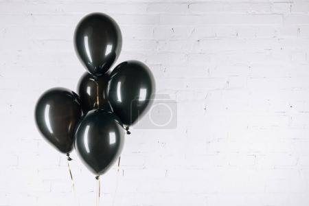shiny black balloons