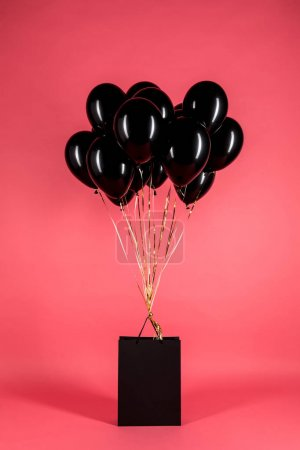 black balloons and shopping bag