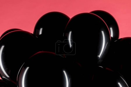 Photo for Close up view of black shiny balloons isolated on pink - Royalty Free Image