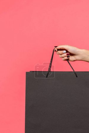 Person holding shopping bag