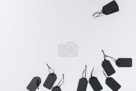 Photo for Top view of arrangement of black blank tags isolated on white - Royalty Free Image