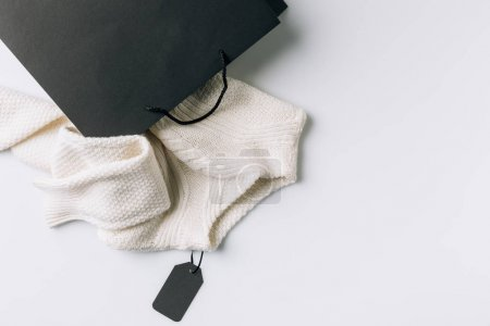 paper bag with sweater inside
