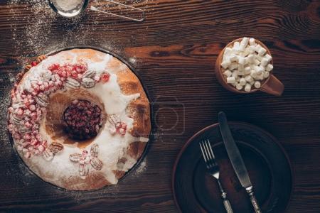 Christmas cake, plate and cocoa
