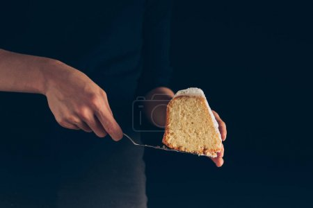 hands with piece of cake