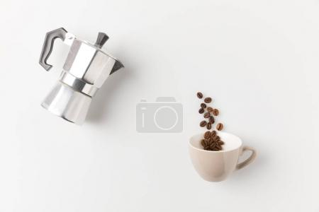 Coffee beans pouring from pot