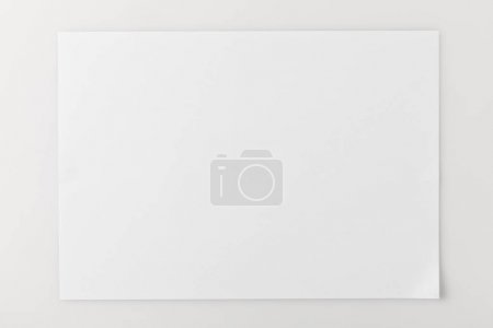 Photo for Top view of blank paper on white surface - Royalty Free Image