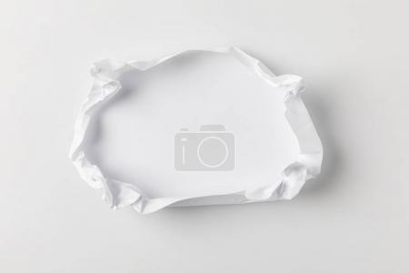 Photo for Top view of crumpling blank paper on white tabletop - Royalty Free Image