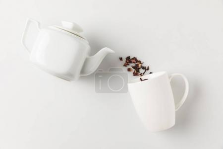 tea pouring from pot into cup