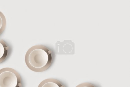 Photo for Top view of empty coffee cups on white tabletop - Royalty Free Image