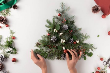 hand making christmas tree