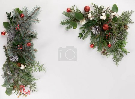 fir branches with christmas balls and cones