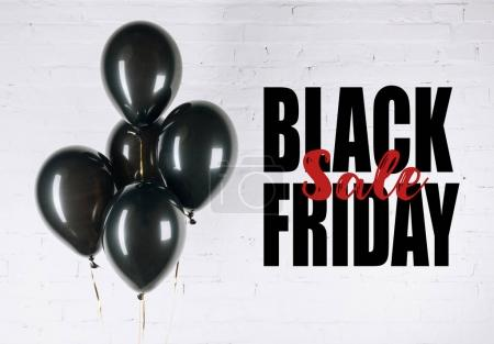 Photo for Close-up view of shiny black balloons on white - Royalty Free Image