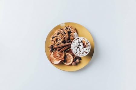 Photo for Top view of plate with cookies and cup of hot cacao with marshmallows, isolated on white - Royalty Free Image