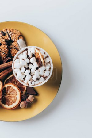 Photo for Top view of plate with cookies and cup of hot cacao with marshmallows, on white - Royalty Free Image