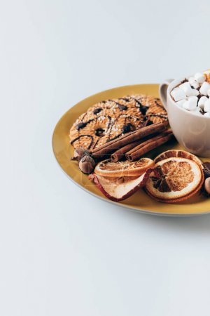 Photo for Plate with cookies and cup of hot chocolate with marshmallows, isolated on white - Royalty Free Image