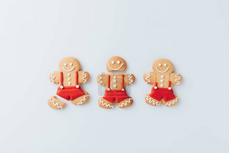 Top view of sweet gingerbread men, isolated on whi...