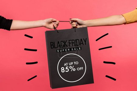women pulling shopping bag