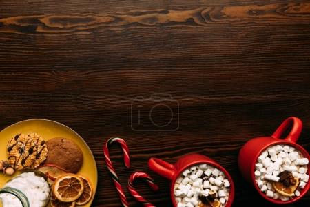cookies and cups of hot cacao