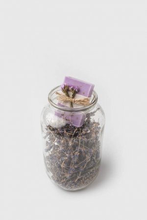 Soap in jar with lavender flowers