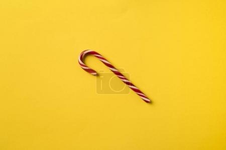 Photo for One candy cane isolated on yellow - Royalty Free Image