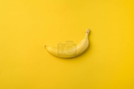 Photo for One ripe banana isolated on yellow - Royalty Free Image
