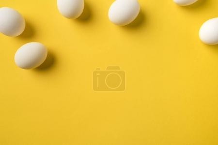 Photo for Top view of Natural Chicken eggs isolated on yellow - Royalty Free Image