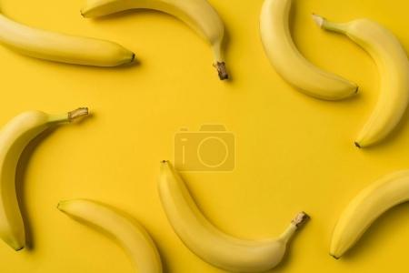 Photo for Top view of ripe bananas isolated on yellow - Royalty Free Image