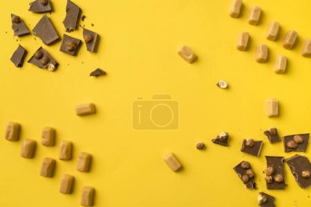 Pieces of chocolate and iris milk candies