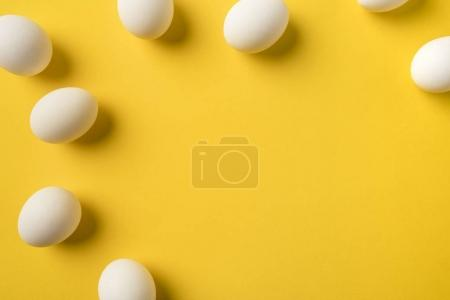 Photo for Top view of Uncooked Chicken eggs isolated on yellow - Royalty Free Image
