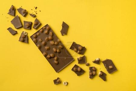 Chocolate bar with scattered pieces