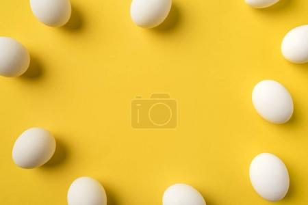 Photo for Unprocessed Chicken eggs isolated on yellow - Royalty Free Image