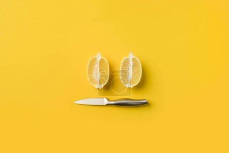 Knife and lemons halves