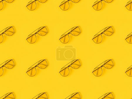 Photo for Set of stylish Glasses isolated on yellow - Royalty Free Image