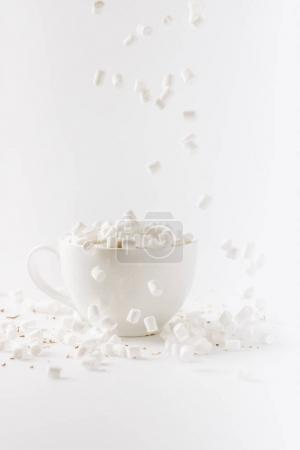 Photo for Aromatic hot chocolate with falling marshmallows, isolated on white - Royalty Free Image