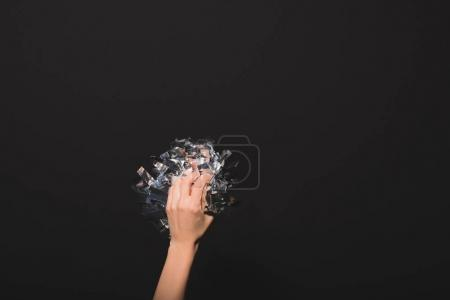 Photo for Cropped image of woman holding silver confetti in hands isolated on black - Royalty Free Image