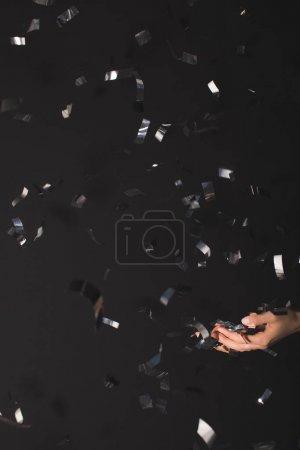 woman catching falling confetti