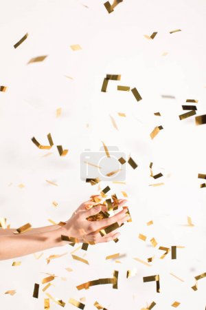 woman catching falling confetti