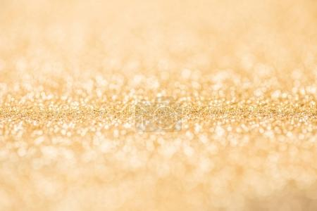 Photo for Close up of golden shiny glossing glitter - Royalty Free Image