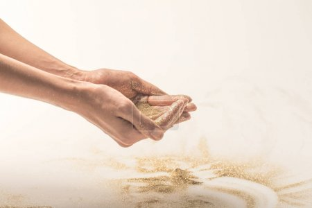 woman holding golden sequins in palms