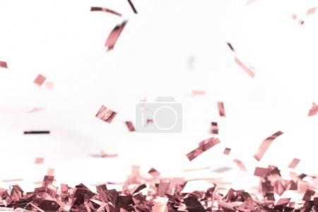 Photo for Muted pink falling confetti on white - Royalty Free Image
