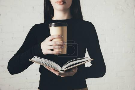 woman with coffee reading book