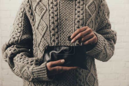 Woman holding wallet with coins
