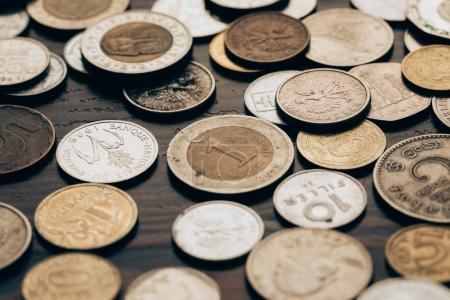 collection of coins on wooden tabletop