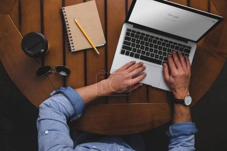 man using laptop with google