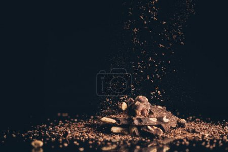 shredded chocolate pieces falling on pile