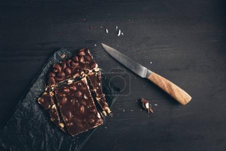 cut chocolate bar and knife