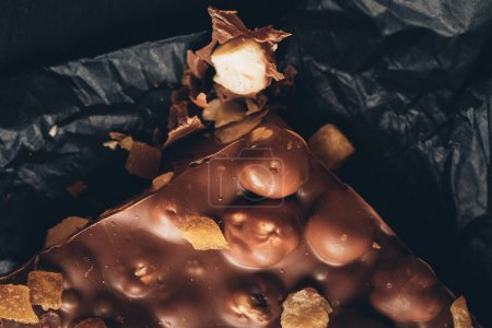 Photo for Top view of milk chocolate with nuts and caramel pieces - Royalty Free Image